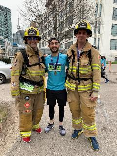 Photo of Ben Bloom with 2 firefighters at run for Camp Ooch